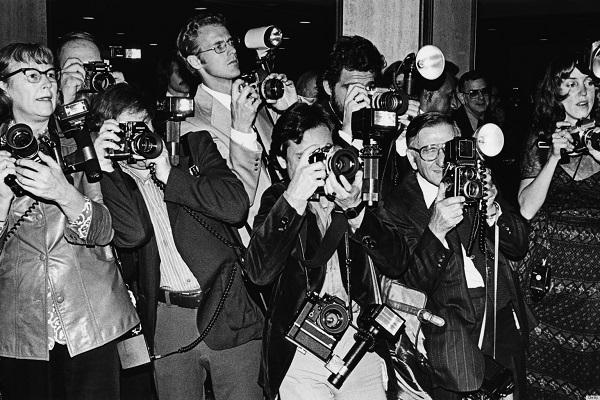 LOS ANGELES - 1979:  A crowd of paparazzi struggle to take photos of arriving musical celebrity at the annual Grammy Awards in Los Angeles, California. (Photo by George Rose/Getty Images)